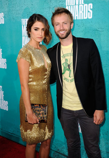 Nikki Reed posed with her husband Paul McDonald on the red carpet at the MTV Movie Awards.