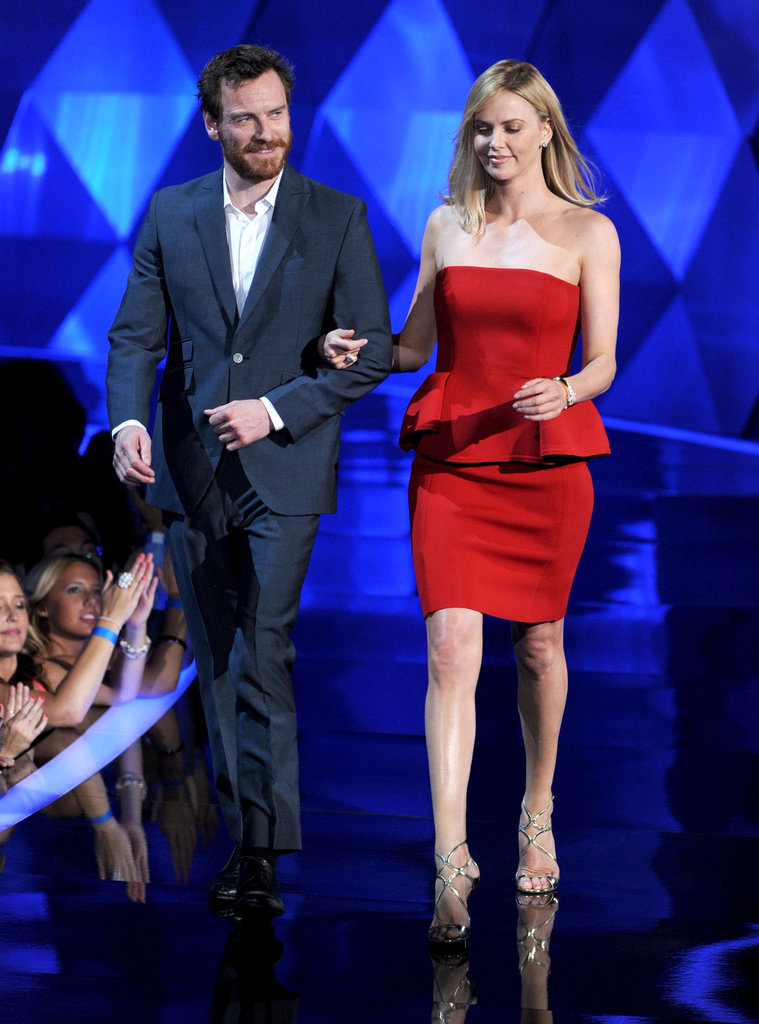 Prometheus stars Michael Fassbender and Charlize Theron floated across the stage together.