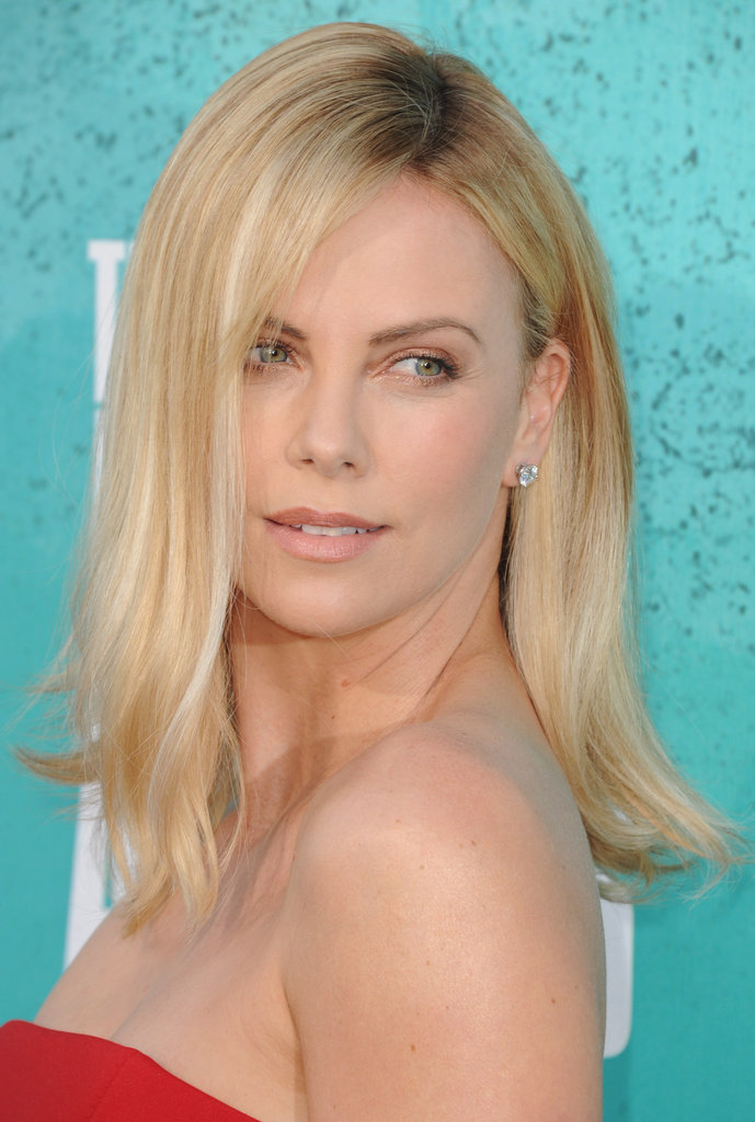 Charlize Theron wore her blond lock down.