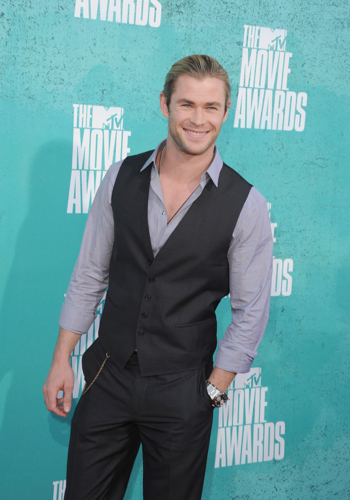 Chris Hemsworth tucked one hand in pocket as he posed for photos.