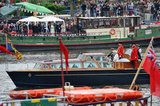 The queen took a smaller boat to the royal barge.