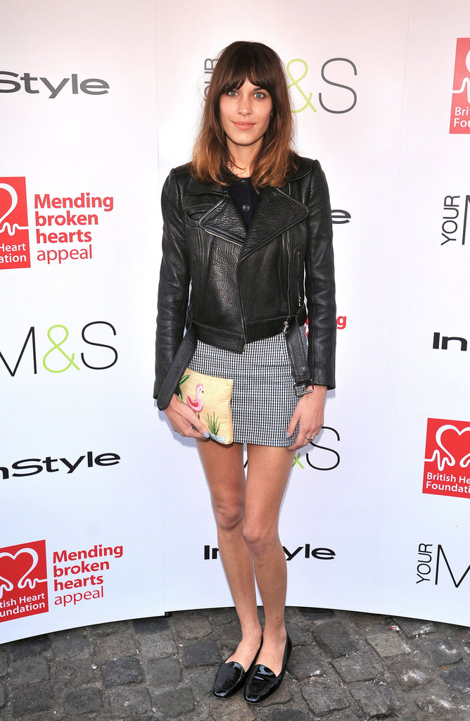 Alexa Chung outfitted a preppy take on the leather jacket for cool event style.