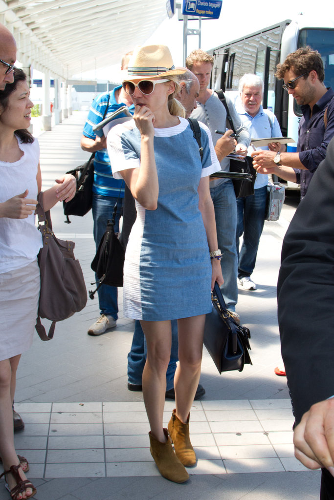 Diane Kruger was the picture of Summer style in a fitted denim dress, a fedora, and her go-to Isabel Marant ankle boots.