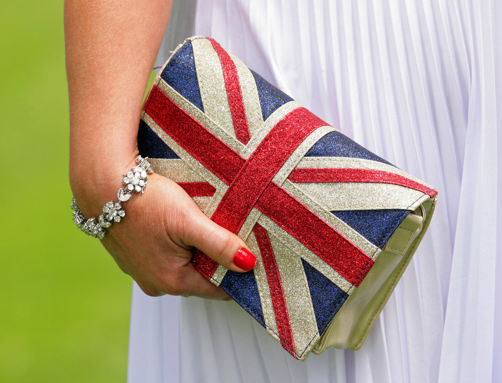 A racegoer clutched her Union Jack purse.
