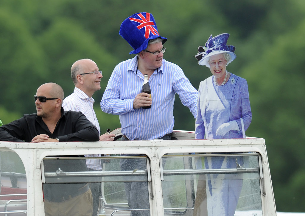 A man stood with a cardboard cutout of the queen.