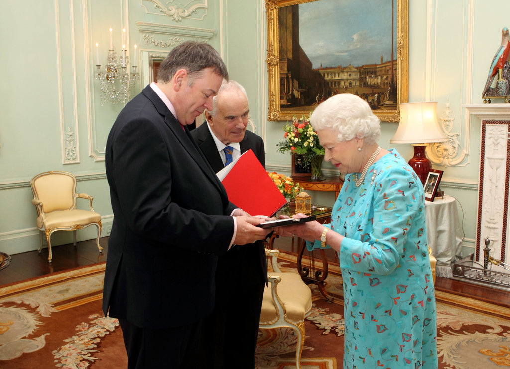 Queen Elizabeth presents Nicholas Daniel with the Queen's Medal For Music at Buckingham Palace on May 31.