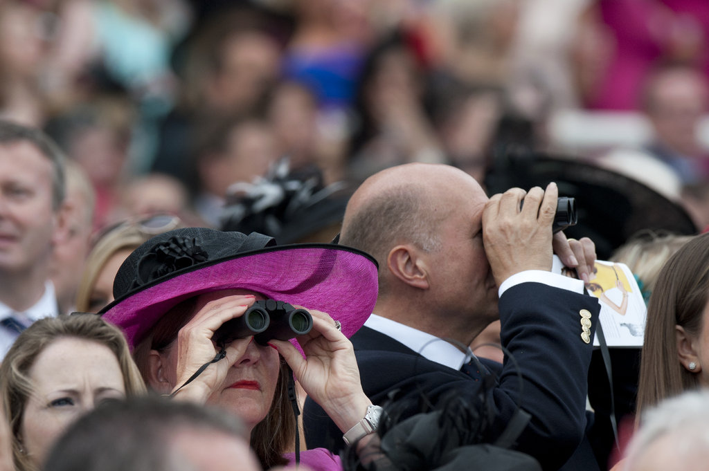 A couple checked out the Epsom Derby with binoculars.
