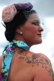 A woman showed off her Ladies Day ensemble and tattoos.