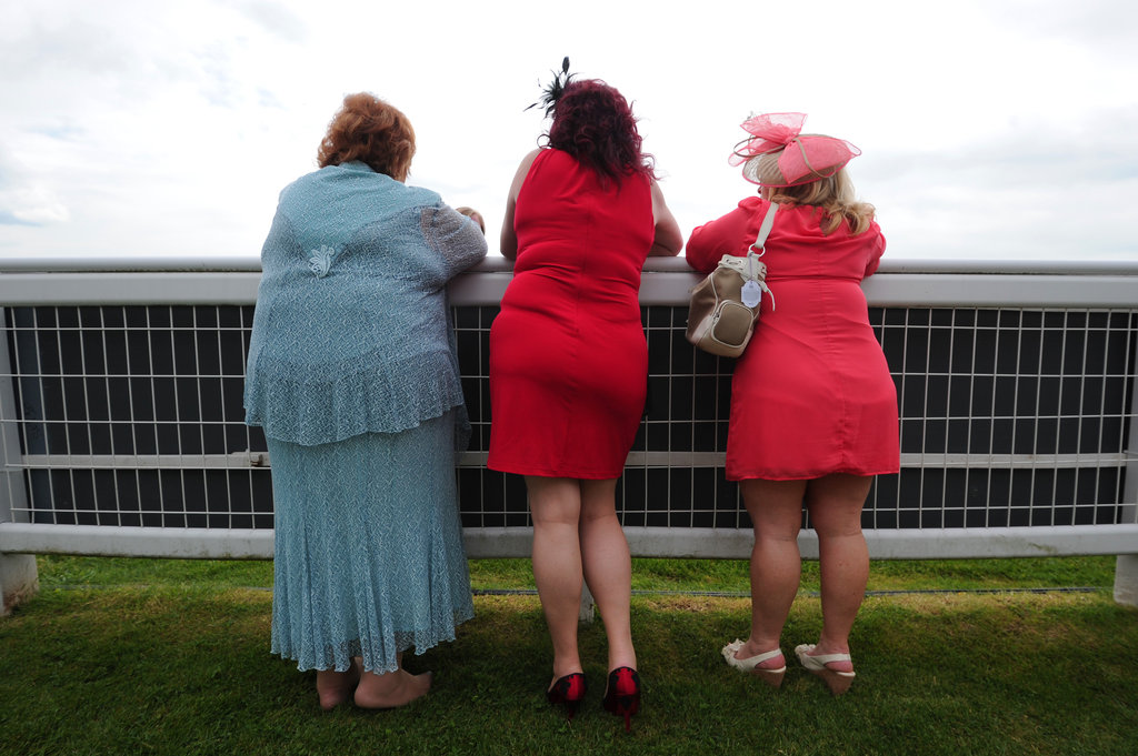 Three ladies watched the races.