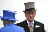 Prince Philip, Duke of Edinburgh, stood with the queen.