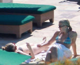 Busy Philipps and Scarlett Johansson chatted by the pool.