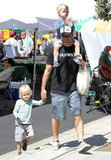 Liev Schreiber kept an eye on sons Sasha and Kai when they checked out an LA farmers market together in April 2012.