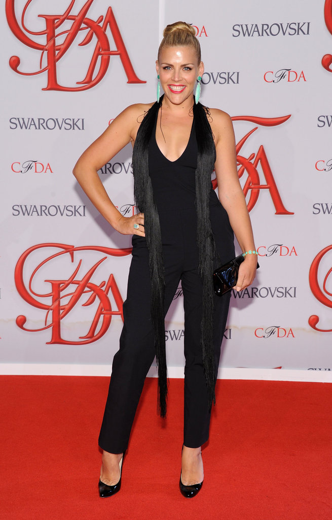 Busy Philipps walked the red carpet in a black jumpsuit and heels and was adorned with Irene Neuwirth baubles.