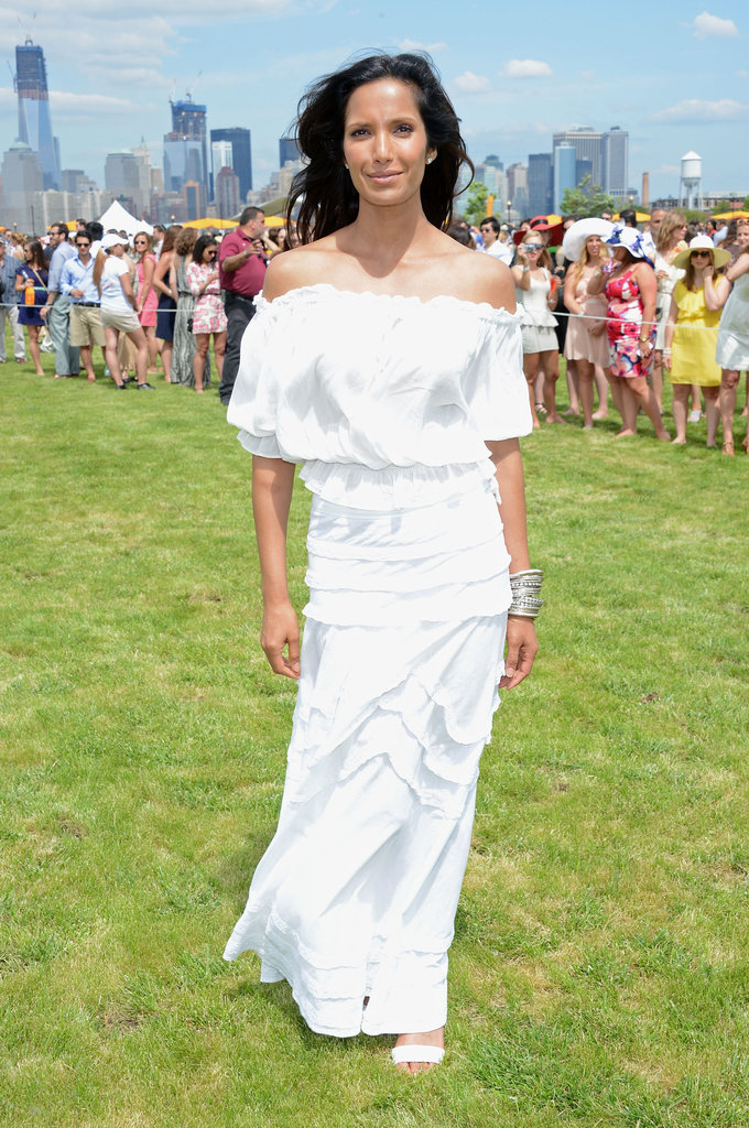 Padma Lakshmi glowed in this off-the-shoulder white maxi dress — to complement the look, she rocked a bold silver cuff.