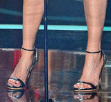 Jennifer Aniston took the stage in a pair of strappy Giuseppe Zanotti heels.