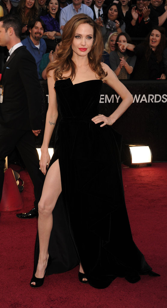 Angelina made headlines at the Oscars in 2012 thanks to the thigh high split of her Versace velvet gown, and her proud posing.