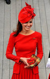 The fitted top on Kate's dress kept the look youthful, while pleats felt classic and ladylike.