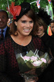 Princess Eugenie wore a black and coral Stephen Jones hat.