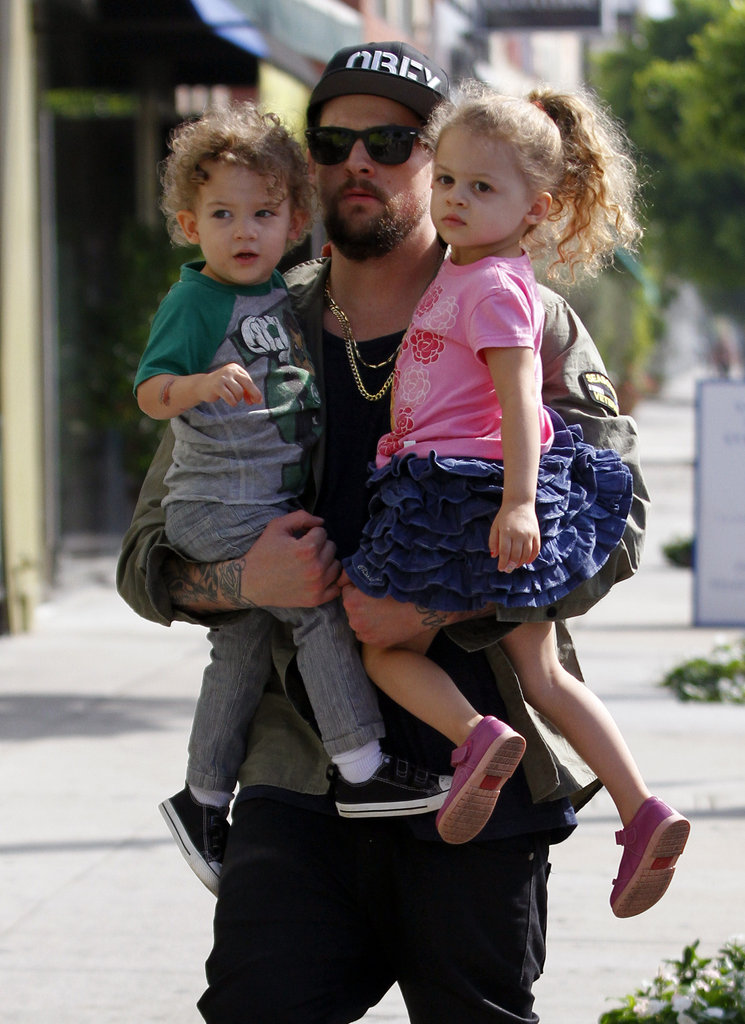 In September 2011, Joel Madden carried his kids around LA.