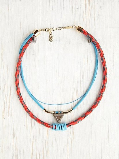 Set a bohemian tone with this tribal rope necklace and don't stop there — use the collar silhouette as the foundation for some mix-and-match necklace layering. Free People Tribal Rope Layering Necklace ($98)
