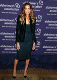 On another occasion, SJP paired an embroidered sheath dress with an emerald velvet Yves Saint Laurent blazer, black suede Manolo Blahnik pumps, and Fred Leighton jewels. 7093545