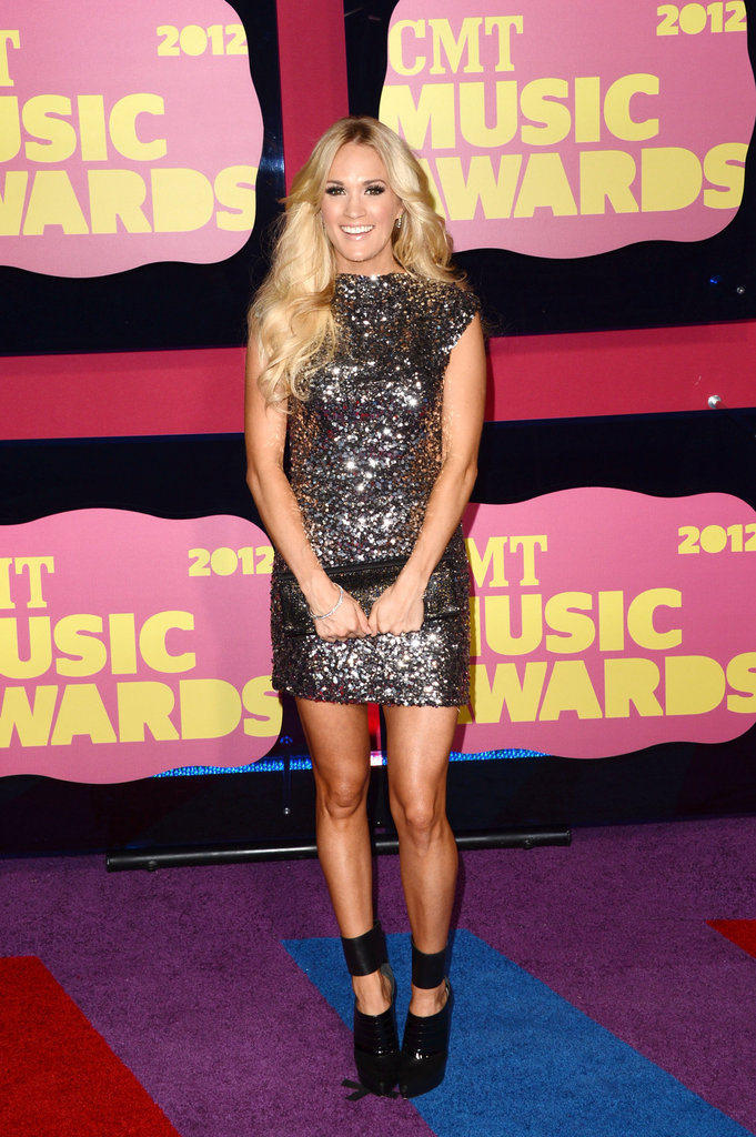 Carrie Underwood wore a sequined Randi Rahm dress to the CMT Music Awards.