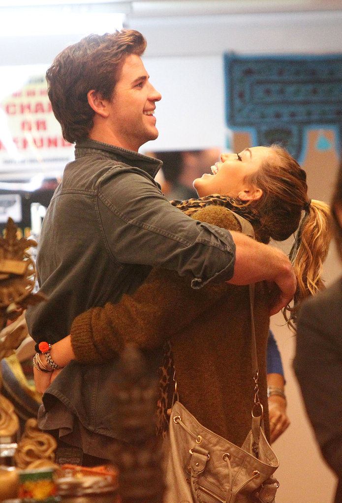 Miley Cyrus and Liam Hemsworth got playful while shopping in Sydney during a June 2011 trip there.