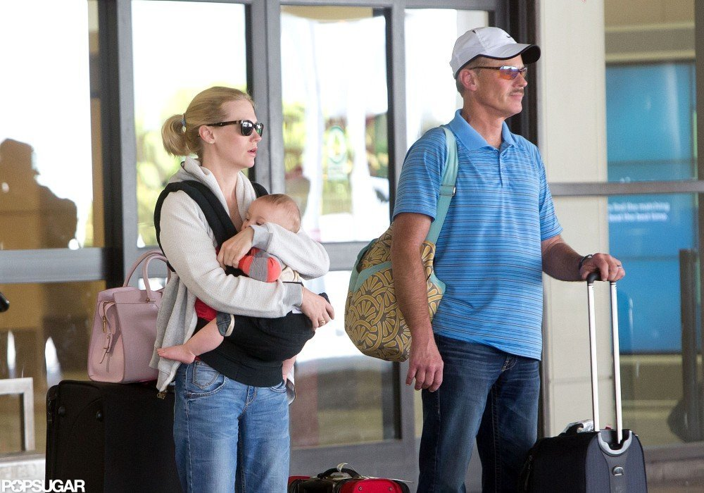 January Jones held tight to Xander while waiting to be picked up at LAX.