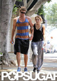Liam Hemsworth and Miley Cyrus stuck together while walking in LA in July 2010.