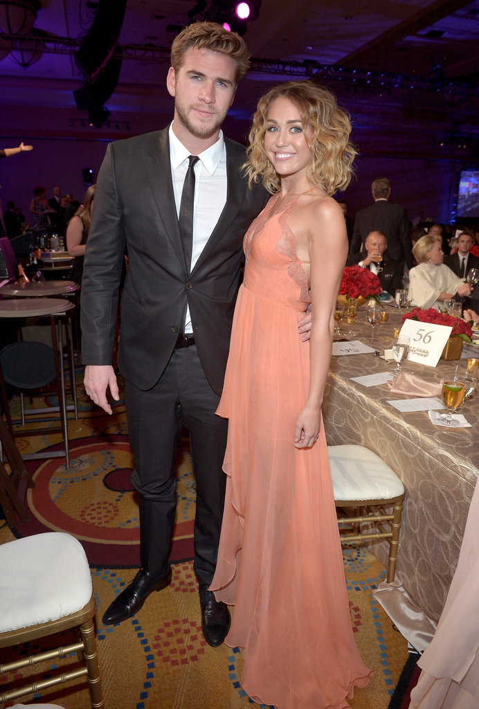 Miley Cyrus and Liam Hemsworth stuck together at Muhammad Ali's Celebrity Fight Night in March 2012.