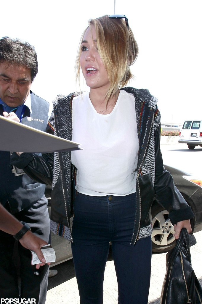 Miley Cyrus arrived at LAX wearing her engagement ring.