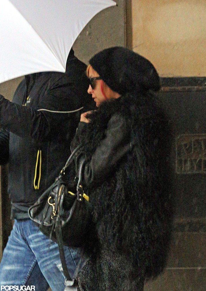 Nicole Richie hid her pink hair under a black hat in Australia.