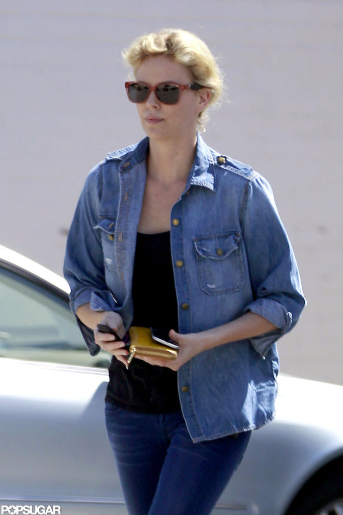 Charlize Theron wore her hair up.
