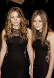 Ashley Olsen wore her hair wavy while Mary-Kate Olsen straightened her locks for Vanity Fair's Oscar party in 2002.