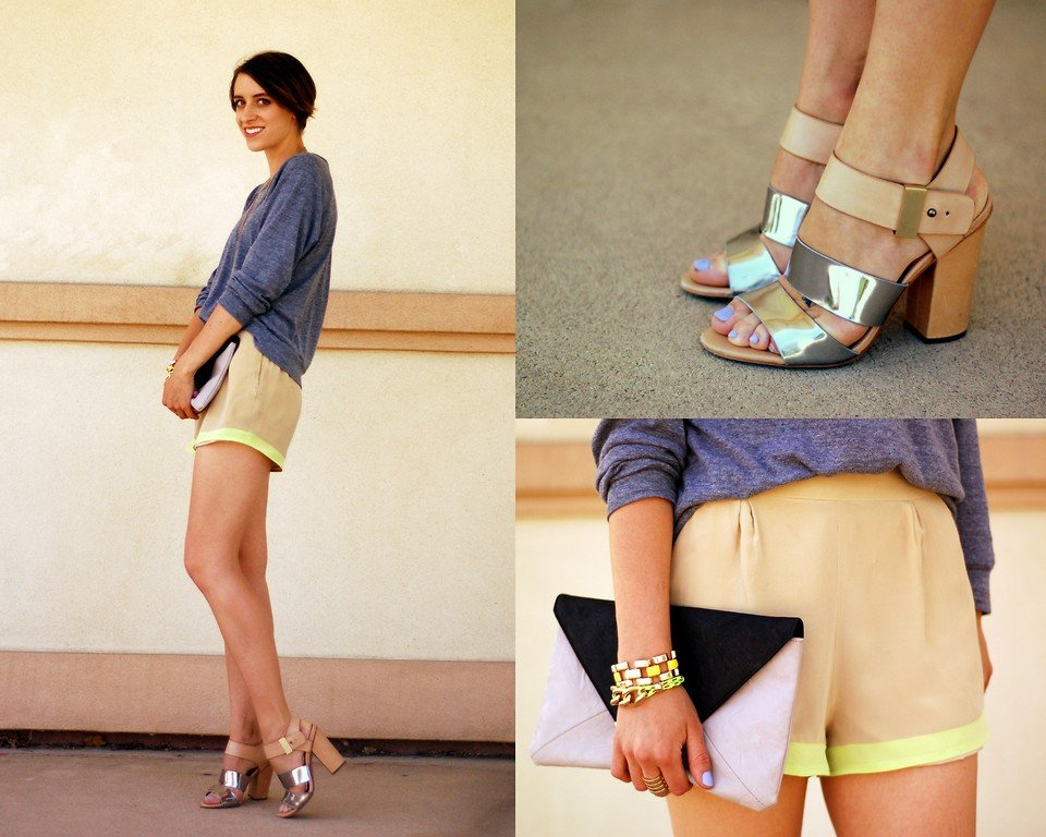 We love this neon-infused spin on a sporty sensibility. To get a similar feel, just tuck in a cozy topper to a neon-trimmed silk short; then, add metallic heels. Photo courtesy of Lookbook.nu