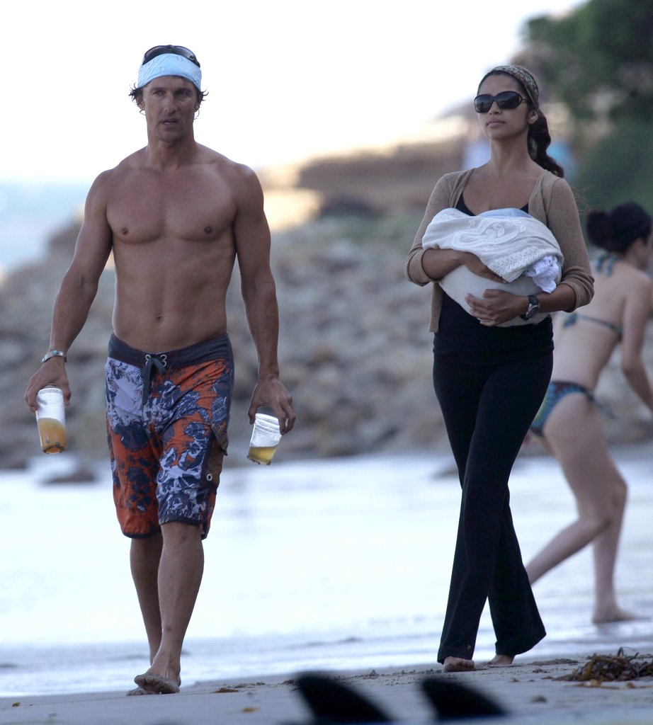 Matthew McConaughey went shirtless for a day at the beach in Malibu with Camila Alves and little Levi in August 2008.