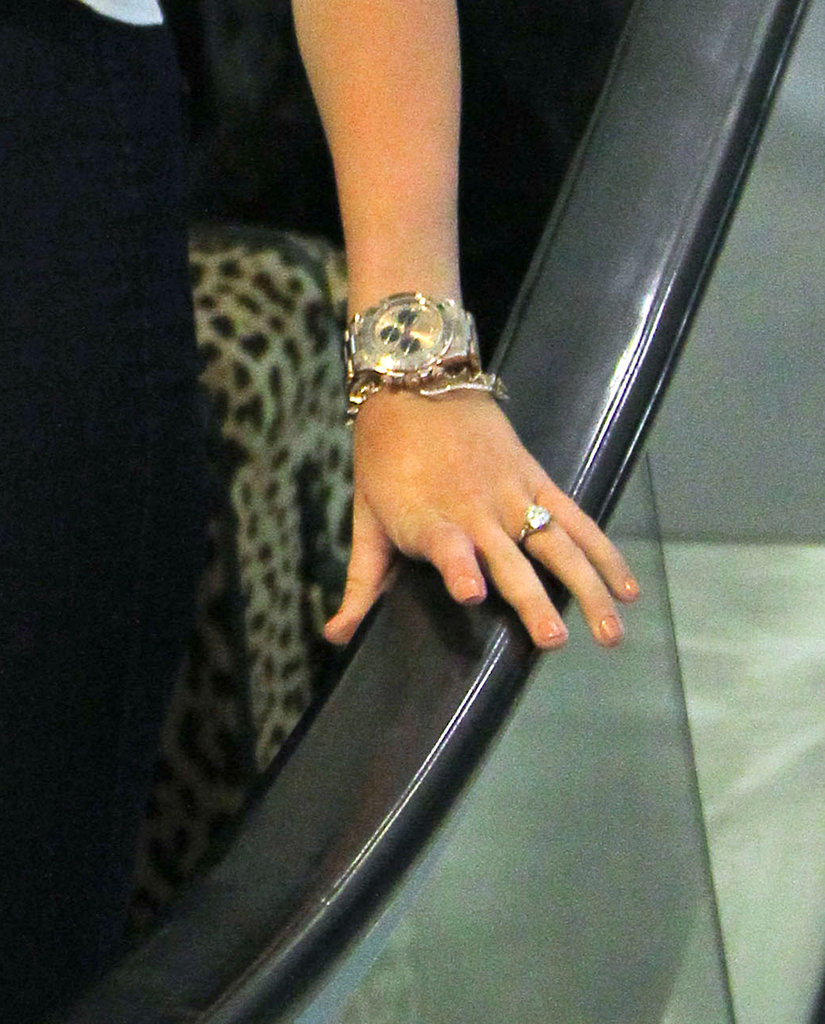 Miley Cyrus wore her engagement ring as she arrived in New Orleans.