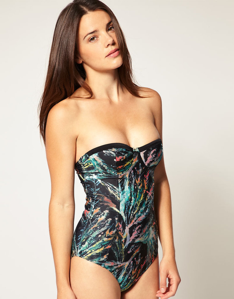 This all-over digital print offers a high-impact twist on the one-piece — plus a bustier-style top offers extra support.  Insight Feather Print Halter-Neck Suit ($114)