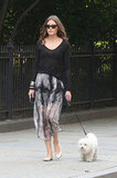 Olivia Palermo made taking her pup for a stroll look incredibly chic in a semisheer skirt and ballet flats.