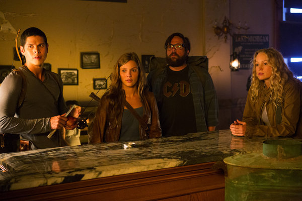 JD Pardo as Nate, Tracy Spiridakos as Charlie, Zak Orth as Aaron, and Anna Lise Phillips as Maggie on Revolution.