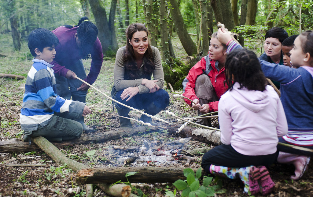 Kate Middleton hung out by a campfire with children from Expanding Horizons primary school outdoor camp.