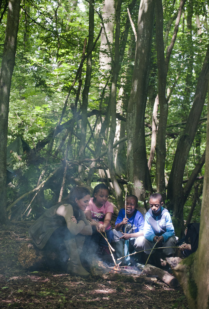 Kate Middleton started a campfire with children from Expanding Horizons' primary school outdoor camp.