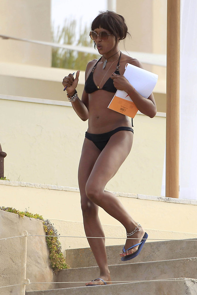 Naomi Campbell was on the go in a black bikini while in Ibiza.