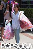 Jessica Alba carried bags after Honor's birthday party.