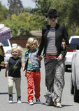 Gwen Stefani wore a black fedora and shades as she walked with her boys to a party in Long Beach.