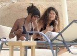 Naomi Campbell laid out in her bikini with a friend in Ibiza.