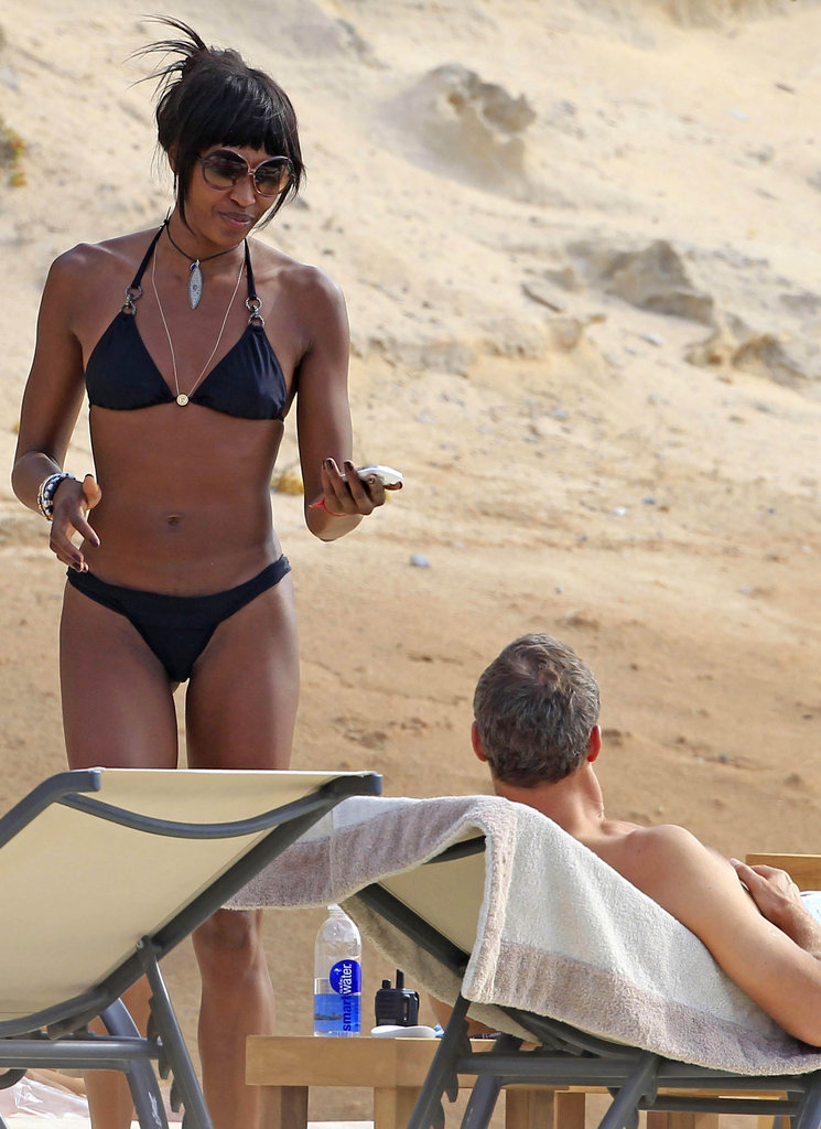 Naomi Campbell wore a black bikini on the beach in Ibiza.