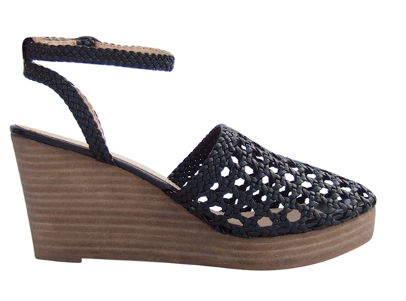 This woven ankle-strap wedge is a go-with-anything Summer shoe that would look just as great with a pretty dress at dusk as it would during a day of sightseeing. Marais USA Halter Espadrille Black ($130)