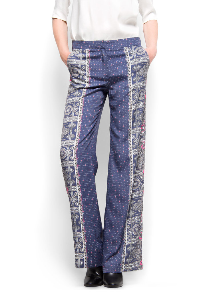 Indulge yourself by wearing these loose-fitted trousers. Worn with sleek sandals and a blouse, they could easily make for a casual or evening-appropriate outfit. Mango Contrasted Printed Palazzo Trousers ($50)