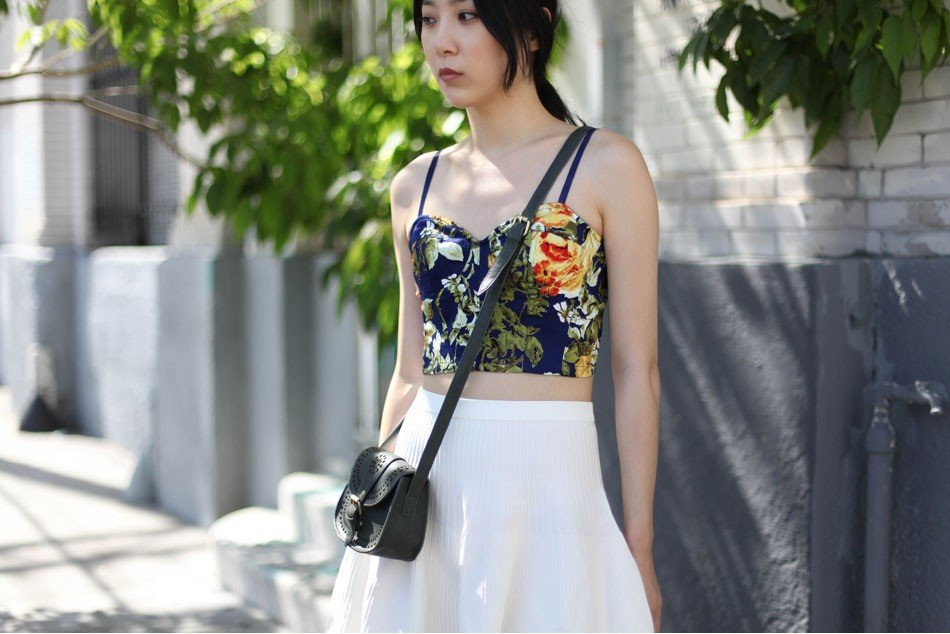 Feel like baring a bit more skin? Try a cropped top in a tropical floral print. Mikkat Market Floral Bustier ($28)